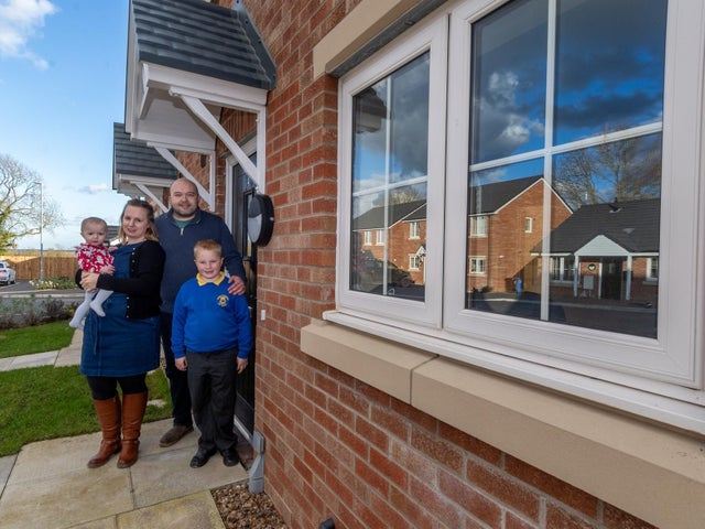 Pictured Ellen, 27, Brendan, 34, Dyson and their children Riley, 7, and Phoebe, aged 9 months, who have just bought their first home together through a shared ownership scheme in Hutton Cranswick, East Yorkshire. Copyright: Yorkshire Post / James Hardisty